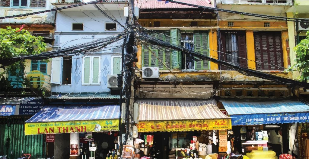 Tube houses and the tangle of electrical wires in Vietnam.